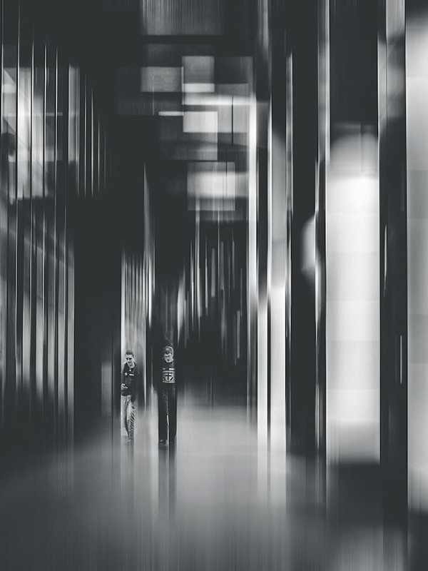 Two-men-walking-along-futuristic-stree