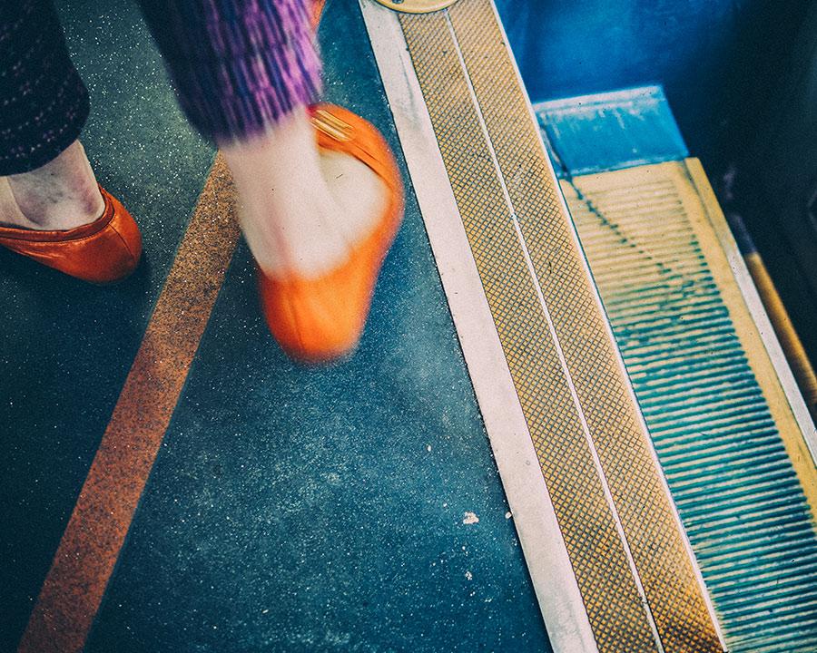 image-of-woman's-feet-walking-in-tram