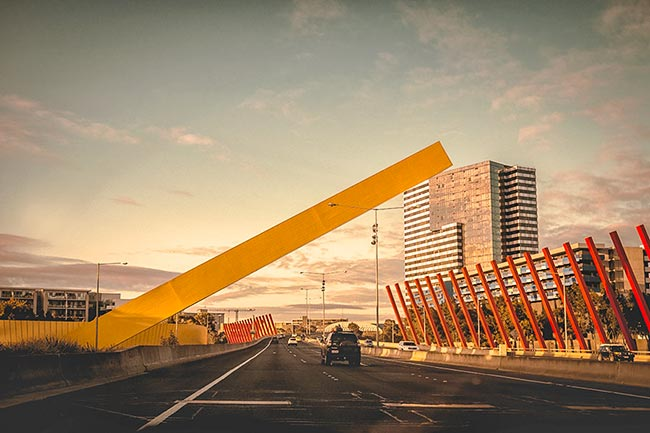 street-sculpture-appearing-to-lean-on-building-