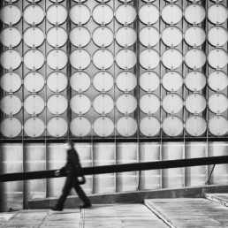 Man-walking-past-RMIT-building-in-Melbourne